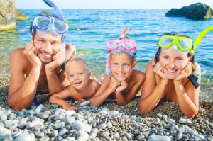 Family snorkeling at beach in southern California